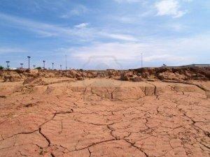 2738752-shot-of-desert-soil-cracking-from-drought