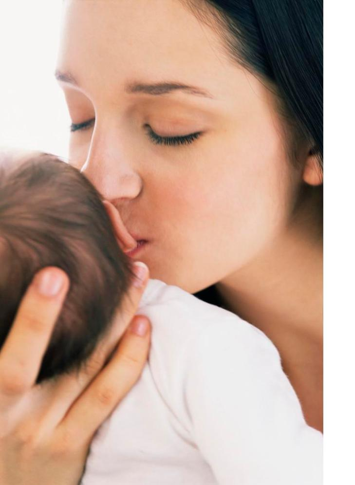 Young Mother Kissing Infant