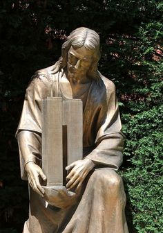 Sculpture of Jesus embracing the twin towers outside St. Ephrem Church in the Dyker Heights neighborhood of Brooklyn.