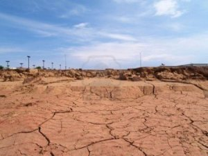 2738752-shot-of-desert-soil-cracking-from-drought